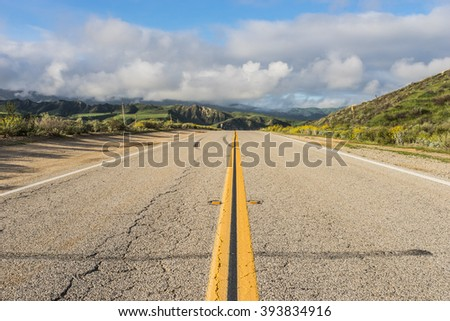 Low view of road leading into California's central valley near Ventura. - stock photo