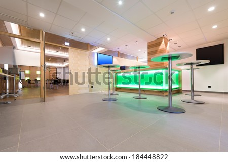 low view to wooden foyer with illuminated bar desk - stock photo
