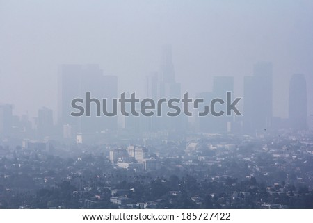Low visibility caused by pollution problem in urban area - stock photo
