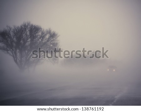 Low visibility on a foggy road - stock photo