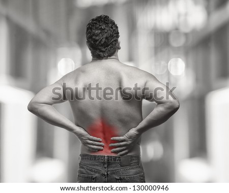 Lower back pain on fit man isolated injury concept - stock photo