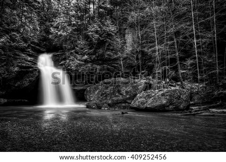 Lower Falls at Old Man's Cave in Hocking Hills Ohio in black and white. This is a very popular tourist attraction in Ohio. - stock photo
