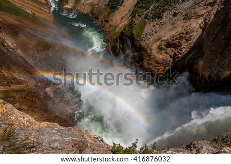 Lower Falls at Yellowstone National Park/ Water and Rainbows - stock photo