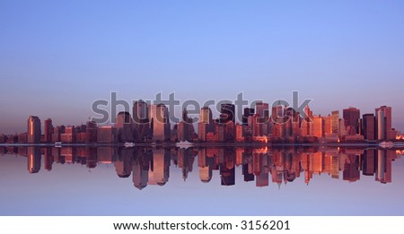 Lower Manhattan and reflection at sunset