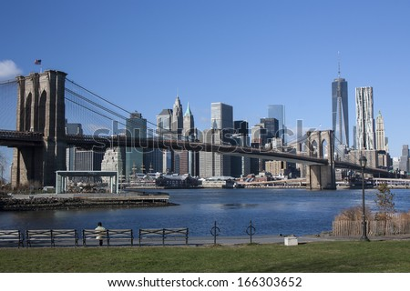Lower Manhattan and the Brooklyn Bridge - stock photo