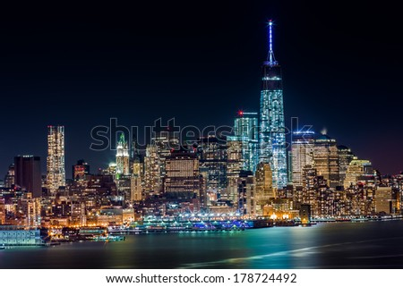 Lower Manhattan by night viewed from Weehawken, New Jersey - stock photo