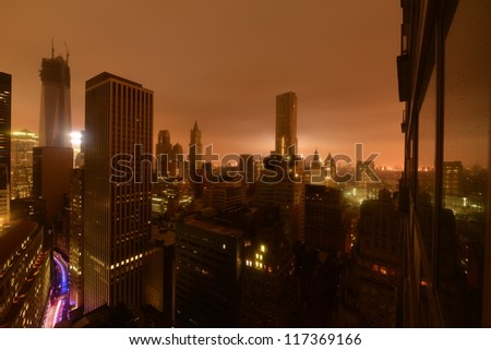 Lower Manhattan following Power Outage as a result of Hurricane Sandy. Police car driving into the distance. - stock photo