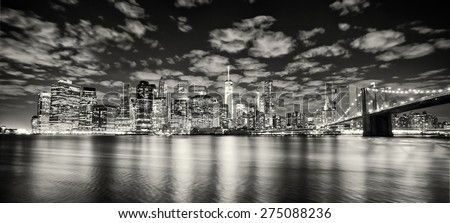 Lower Manhattan skyline and Brooklyn Bridge - stock photo