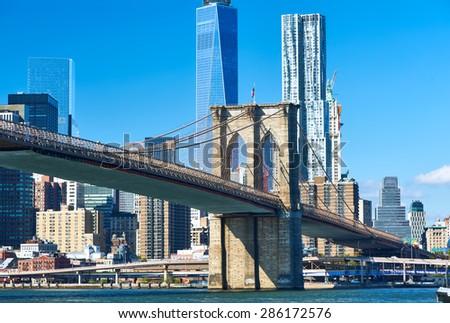 Lower Manhattan skyline and Brooklyn bridge in New York City - stock photo