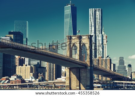 Lower Manhattan skyline and Brooklyn bridge in New York City - stock photo