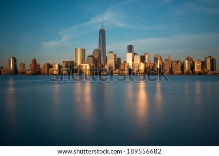 "Lower Manhattan skyline during ""blue hour"" as seen from Exchange Place, New Jersey - stock photo"