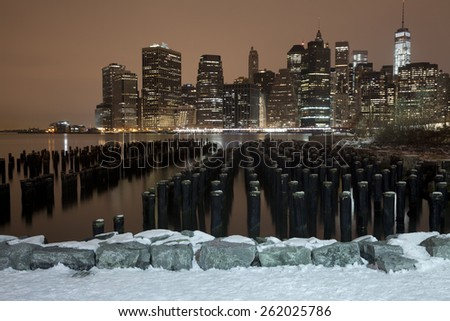 Lower Manhattan skyline night view from Brooklyn Bridge Park in New York City. - stock photo