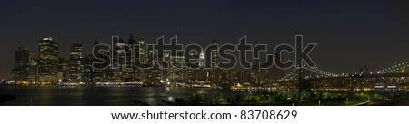 Lower Manhattan skyline panorama with Brooklyn Bridge.