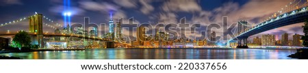 Lower Manhattan skyline panorama with the Towers of Lights (Tribute in Light) in New York City - stock photo