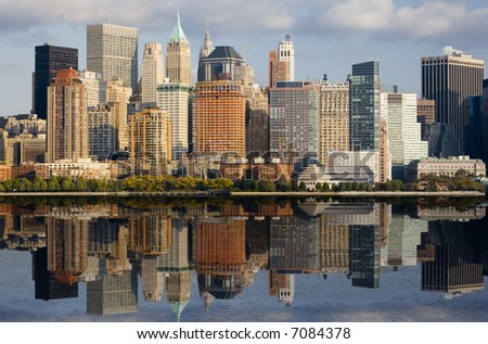 Lower Manhattan with water reflection in Hudson River. - stock photo