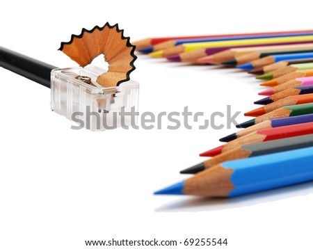 lower view of colored pencils and sharpener on white background - stock photo