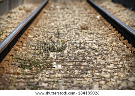 Lower view of train tracks with gravel. - stock photo