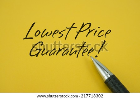 Lowest Price Guarantee! note with pen on yellow background