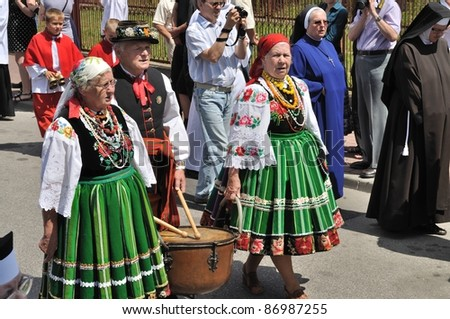 LOWICZ, POLAND - JUNE 23: Participants dressed in regional costumes, walking in the procession of Corpus Christi on June 23, 2011 in Lowicz, Poland.