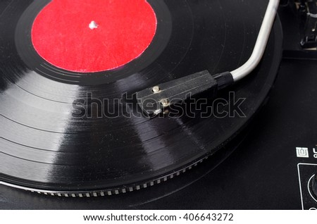 LP disk and disk player - stock photo