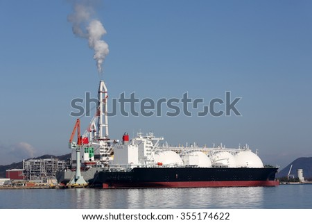 LPG cargo ship docked in the port - stock photo