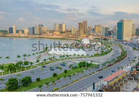 LUANDA, ANGOLA - APRIL 28 2014: View over the skyline of Luanda with constructions cranes, highway and the Luandan bay