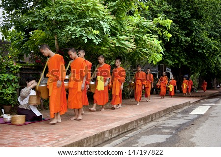 LUANG PRABANG-JULY 22: Every day very early in the morning, hundreds of monks walk the streets to beg on july 22, 2009 in Luang Prabang, Laos.