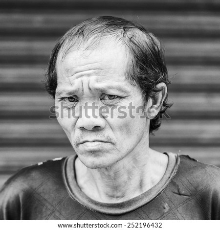 LUANG PRABANG, LAOS - SEP 25, 2014: Unidentified Lao man portrait. 55% of Laos people belong to the Lao ethnic group
