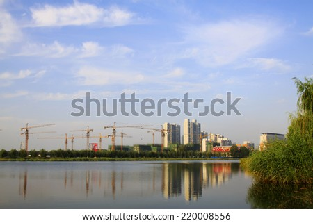 LUANNAN COUNTY -  AUGUST 27: Urban construction sites by a park, on august 27, 2014, Luannan County, Hebei Province, China