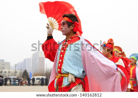 LUANNAN COUNTY - FEBRUARY 24: During the Chinese Lunar New Year, people wear colorful clothes, yangko dance performances in the streets, on February 24, 2013, Luannan County, Hebei Province, China.