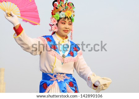 LUANNAN COUNTY - FEBRUARY 26: During the Chinese Lunar New Year, people wear colorful clothes, yangko dance performances in the streets, on February 26, 2013, Luannan County, Hebei Province, China.