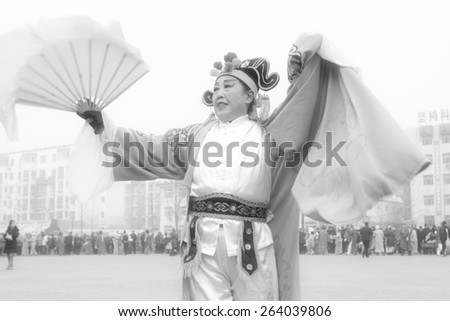 LUANNAN COUNTY - FEBRUARY 15: Performer wearing colorful clothes, performing yangko dance in the street, during the Chinese Lunar New Year, February 15, 2014, Luannan County, Hebei Province, China. - stock photo