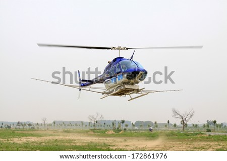 Luannan County, June 20th: The helicopter is landing, prepares to refuel, then off again to spray pesticide, Luannan County, Hebei Province, China, June 20, 2012.
