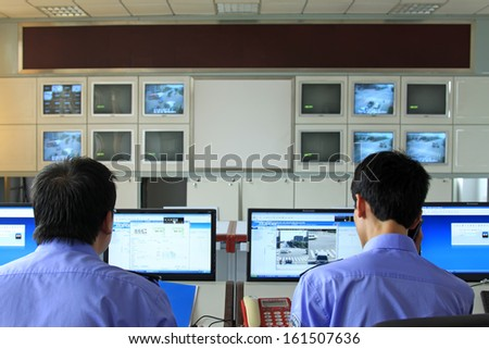 LUANNAN COUNTY - SEPTEMBER 16: Road traffic monitoring system in the room, Public security traffic police brigade on September 16, 2011, luannan county, Hebei province, China.  - stock photo