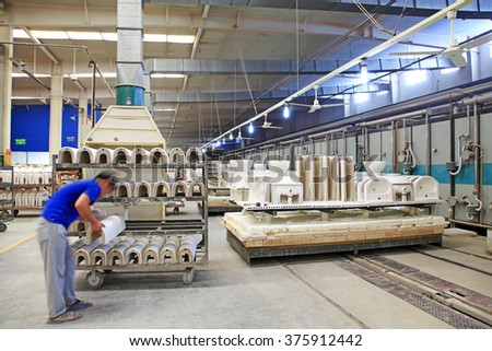 Luannan - May 31: workers in the sintering workshop production line, on May 31, 2015, luannan county, hebei province, China