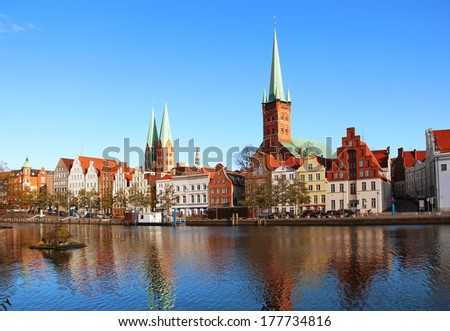 Lubeck old town reflected in Trave river, Germany - stock photo