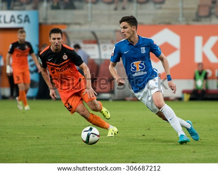 LUBIN, POLAND - AUGUST 14, 2015: Jakub Tosik (L) and David Holman (R) in action during match Polish Premier League between KGHM Zaglebie Lubin - Lech Poznan 2:1. - stock photo