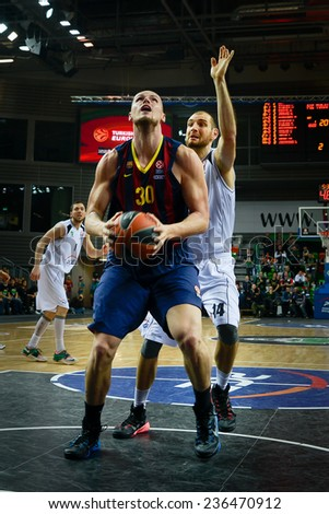 LUBIN, POLAND - DECEMBER 5, 2014:   Maciej Lampe (L) and Vlad Moldoveanu  (R) in action during the Euroleague basketball match between PGE Turow Zgorzelec - FC Barcelona 65:104. - stock photo