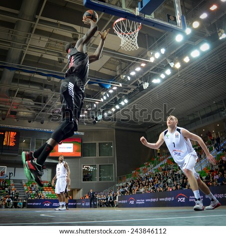LUBIN, POLAND - DECEMBER 18, 2014: Shawn James and Damian Kulig in action during the Euroleague basketball match between PGE Turow Zgorzelec - Emporio Armani Mediolan 96:101 - stock photo