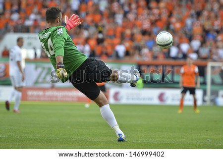 LUBIN, POLAND - JULY 19, Radoslaw Janukiewicz in action during match Polish Premier League between KGHM Zaglebie Lubin - Pogon Szczecin 0:2 on July 19, 2013 in Lubin, Poland. - stock photo