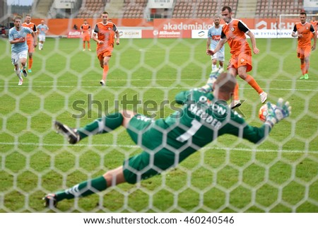 LUBIN, POLAND - JULY 28, 2016: Third Round Elimination to European League match KGHM Zaglebie Lubin - SonderjyskE 1:2. Filip Starzynski shotting penalty, goalkeeper Marin Skender. - stock photo