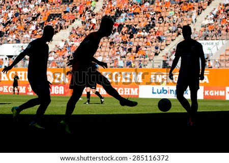 LUBIN, POLAND - JUNE 6, 2015: Silhouettes of players during match Polish 1 League between KGHM Zaglebie Lubin - Termalica Bruk-Bet Nieciecza   1:1. - stock photo