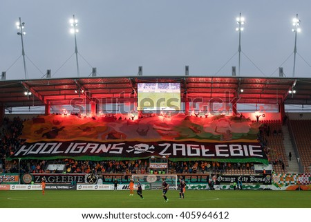 LUBIN, POLAND - MARCH 13, 2016: Fans of Zaglebie burn flares during match Polish Premer League between KGHM Zaglebie Lubin - Pogon Szczecin 1:1. - stock photo