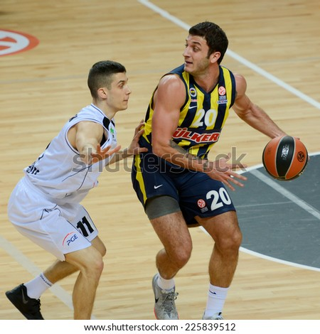 LUBIN, POLAND - OCTOBER 24, 2014: Michael Gospodarek (11) and Can Altintig (20) in action during the Euroleague basketball match between PGE Turow Zgorzelec - Fenerbache Ulker Stambul 76:91. - stock photo