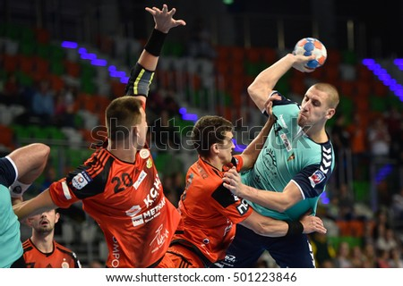 LUBIN, POLAND - OCTOBER 19, 2016: Polish PGNiG Superleague men in handball match between MKS Zaglebie Lubin - Sandra SPA Pogon Szczecin 26:27. In action Pawel Krupa (R).