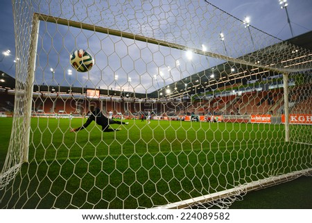 LUBIN, POLAND - OCTOBER 10, 2014: Warm-up Sandecja team before match Polish 1 League between KGHM Zaglebie Lubin - MKS Sandecja Nowy Sacz 1:0 - stock photo