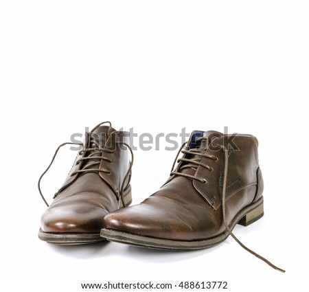 lubricated old shoes on a white background