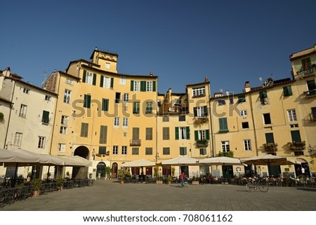 LUCCA, ITALY - APRIL 2017 - Piazza dell'Anfiteatro in Lucca s the most famous town square in the city