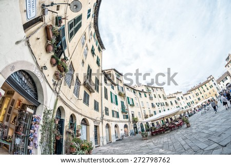 LUCCA, ITALY - APRIL 18, 2015: Tourists and locals in Piazza Anfiteatro. Lucca is one of the most visited town of Tuscany.