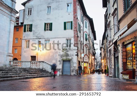 LUCCA, ITALY - JANUARY 16, 2015: Old streets after rain in the evening in Lucca, Italy. Medieval atmosphere.